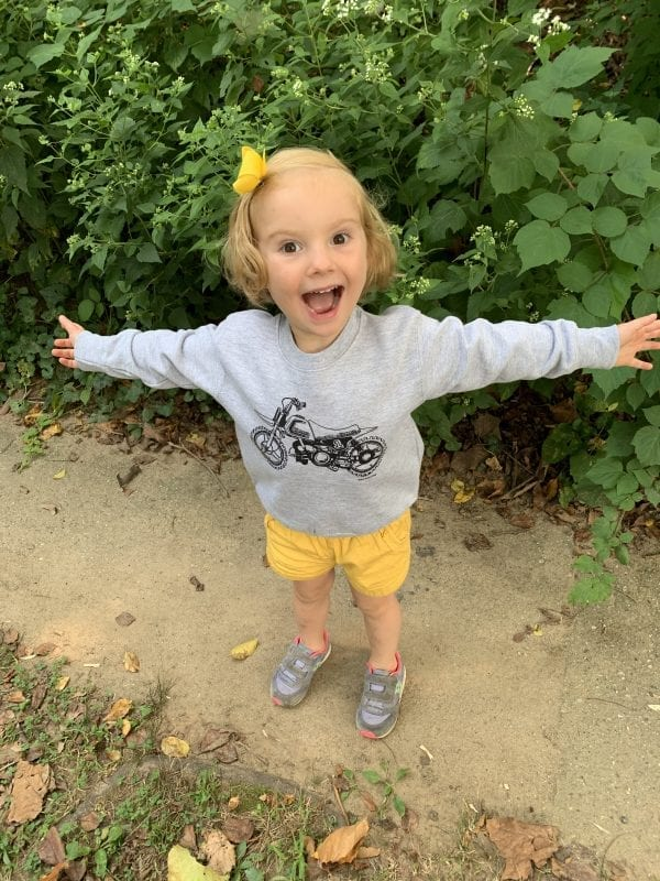 Lou Lou wears the Limited Edition PW50 Children's sweatshirt